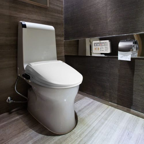 bathroom with bidet seat attachment